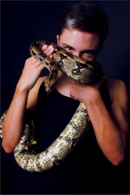 [Boa Constrictor with male model in fashion photo shoot]